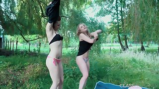 Outdoor lesbian sex between teen lovers with horny pussy
